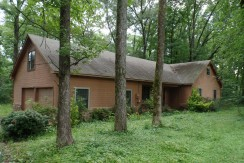Pretty house on 4 acres, great area!